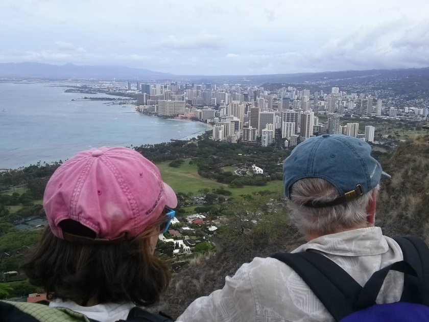 Professors Lisa Gilbert and Jim Carlton overlook Honolulu from atop Diamond Head
