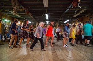 Students dance the cajun two-step in a Louisiana dance hall.