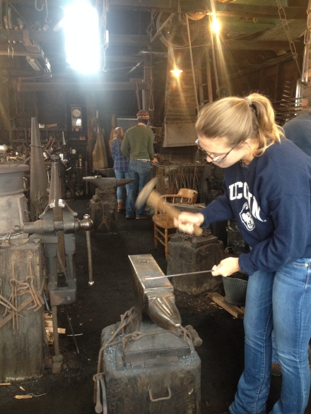 A student works in a forge
